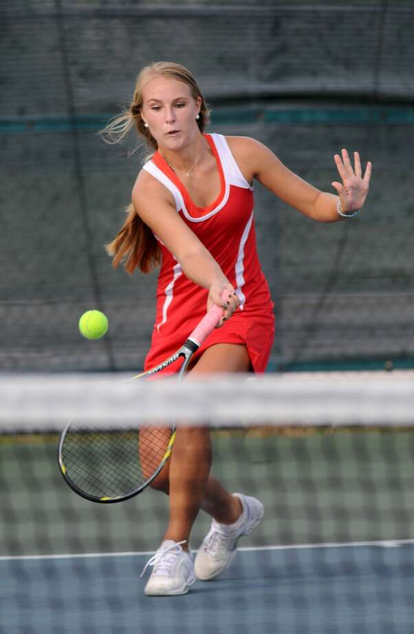 Memorial High School sophomore Libby Bender forehands a ball at the net during her Girls #1 Doubles match with playing partner Meredith Hughes, also a sophomore, during the Mustang's district match against Katy on Oct. 9th. Freelance photo by Jerry Baker Photo: Jerry Baker