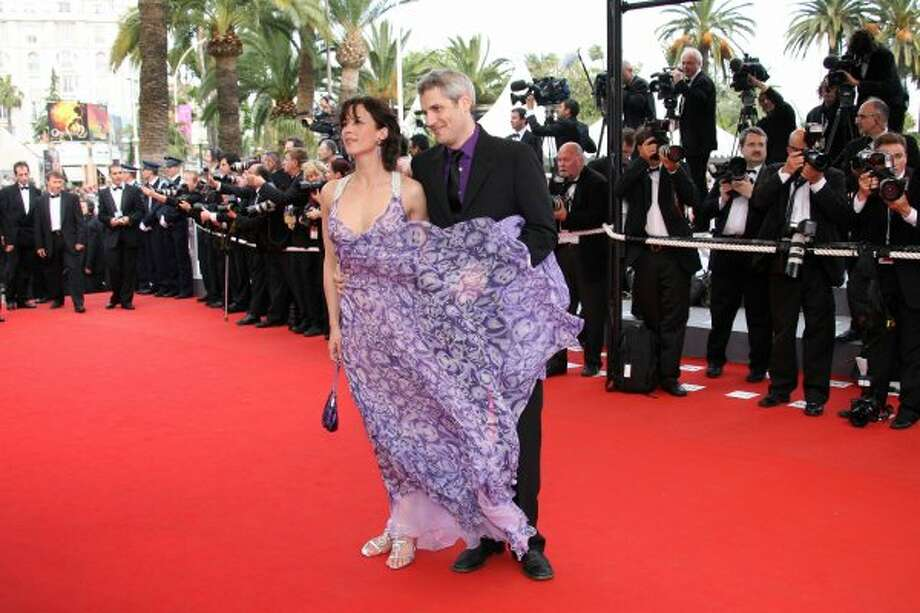 Floaty dress and windy conditions wreak havoc on French actress Sophie Marceau's red carpet pose.  (VALERY HACHE / AFP/Getty Images)