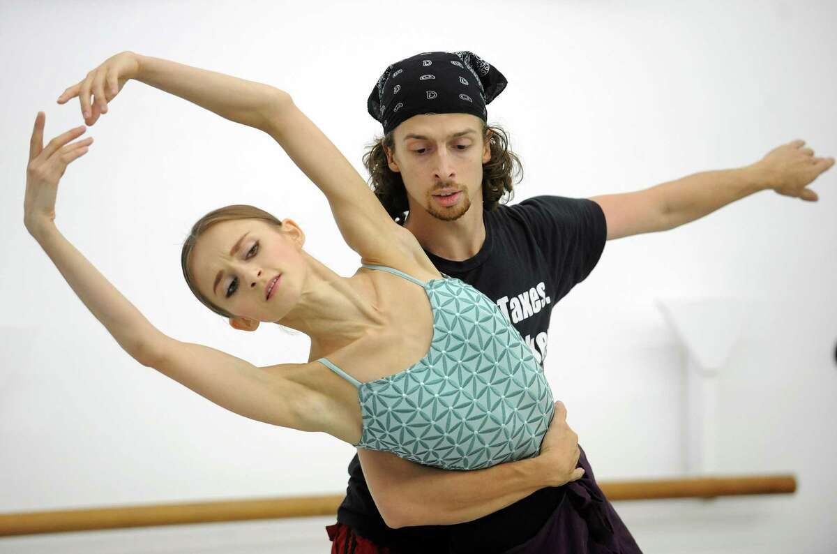 """Anton Kandaurov and Oksana Maslova of the Connecticut Ballet Center dance in a preview of their upcoming show, """"Alice in Wonderland,"""" at their studio in Stamford on Thursday, October 11, 2012. The ballet will be performed Saturday, October 20, at the Palace Theatre in Stamford."""