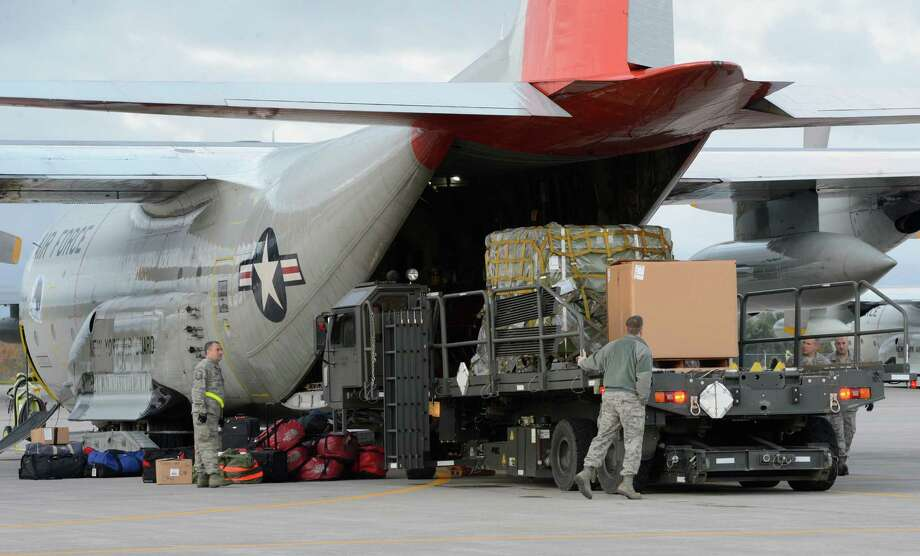 Members of the 109th Airlift Wing load up the annual support mission for the National Science Foundation flight to Antarctica at the Stratton Air National Guard Base in Scotia, N.Y. Oct 16, 2012.       (Skip Dickstein/Times Union) Photo: Skip Dickstein / 00019679A
