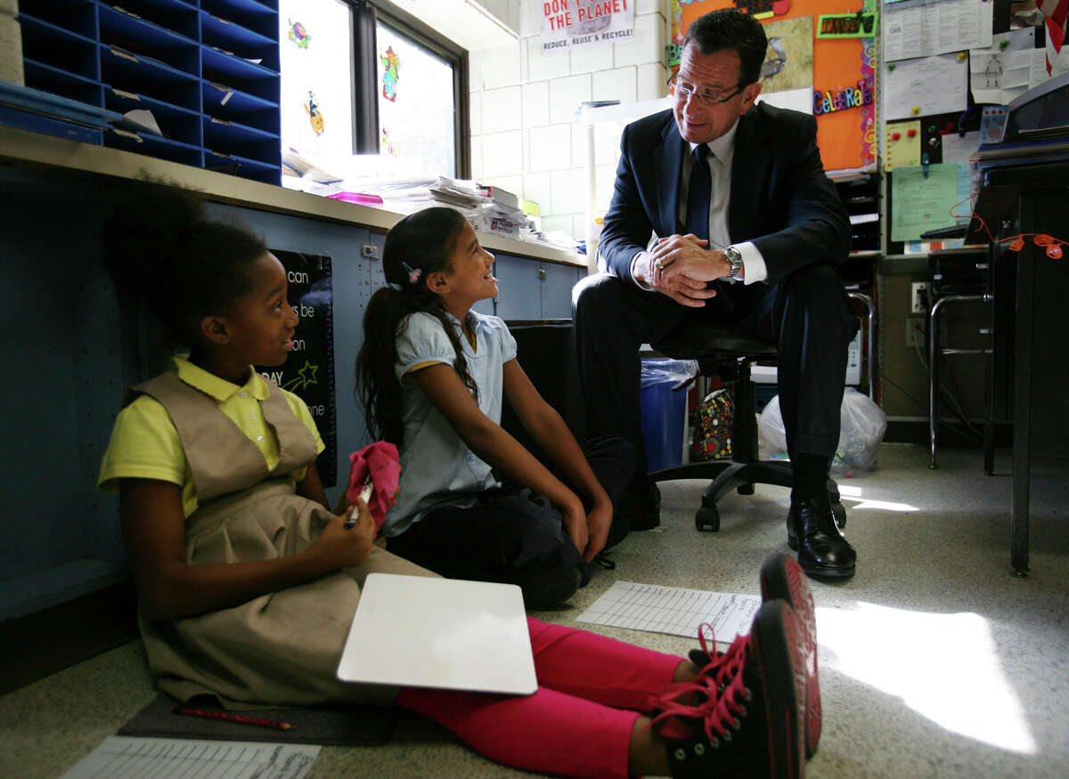 Fourth graders Kwajana Gooden, left, and Nayelis Perez, both 10, chat with Gov. Dannel P. Malloy during his visit to Curiale School in Bridgeport on Tuesday, October16, 2012.