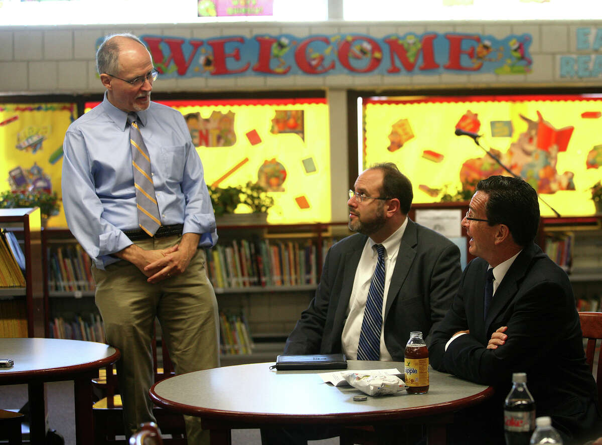 From left; Bridgeport Supt. of Schools Paul Vallas, Commissioner of Education Stefan Pryor, and Gov. Dannel P. Malloy chat during the governor's visit to Curiale School in Bridgeport on Tuesday, October 16, 2012.