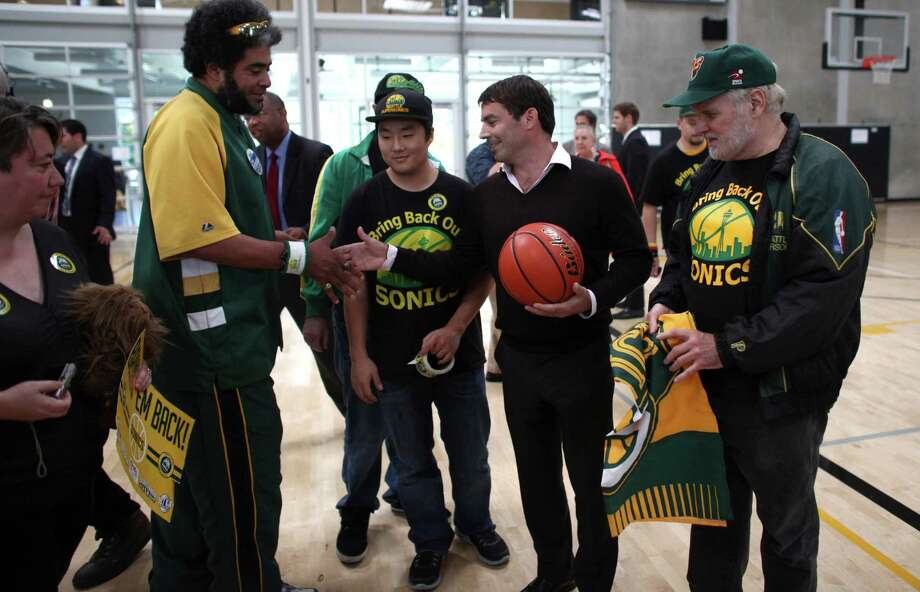 Fans thank investor Chris Hansen after government officials signed a law approving financing of a proposed NBA and NHL arena in Seattle's Sodo neighborhood. Photo: JOSHUA TRUJILLO / SEATTLEPI.COM