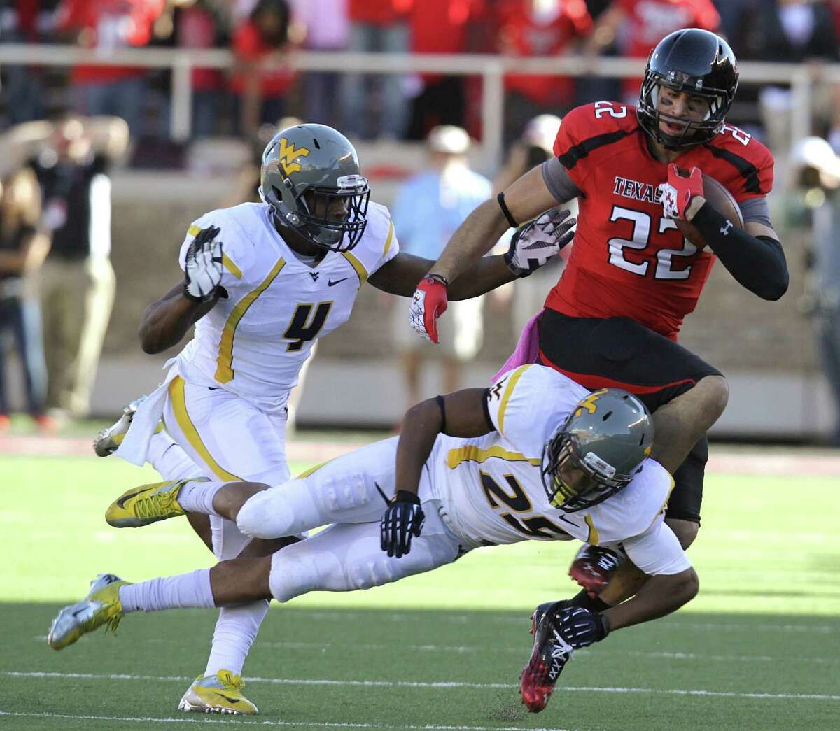 Texas Tech tight end Jace Amaro (right) is hit by West Virginia's Darwin Cook as Josh Francis trails during Saturday's 49-14 Red Raiders victory over the then-No. 5 Mountaineers.