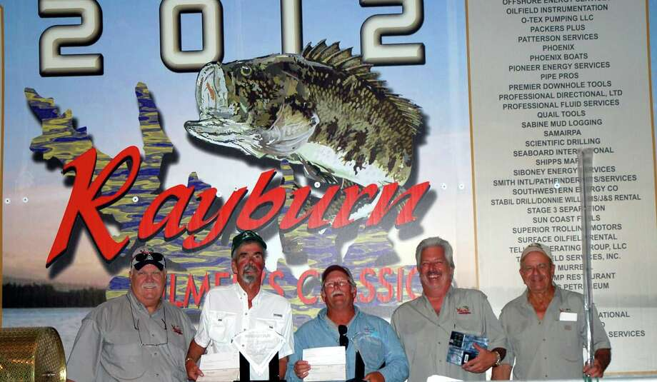 Charlie Parks and other staff members congratulate Carl Kellogg and Jimmy Forsyth upon winning the 16th Rayburn Oilmans Classic Photo: Patty Lenderman