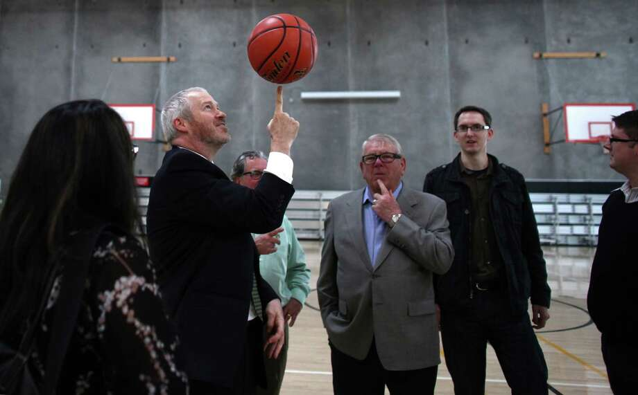 Seattle Mayor Mike McGinn spins a basketball after signing a law approving financing of a proposed NBA and NHL arena in Seattle's Sodo neighborhood. Photo: JOSHUA TRUJILLO / SEATTLEPI.COM