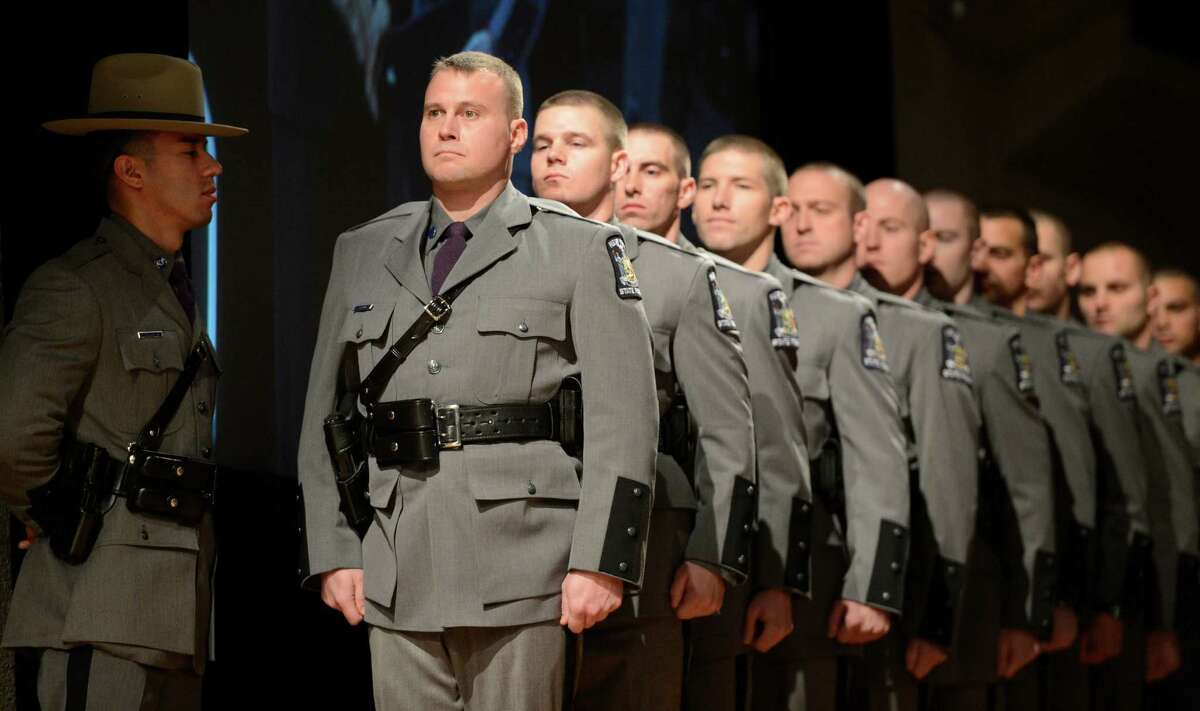 Trooper Jason Beck leads members of the New York State Police to receive their diplomas at the State Police graduation at the Empire State Plaza Convention Center in Albany, N.Y. Oct 16, 2012. (Skip Dickstein/Times Union)