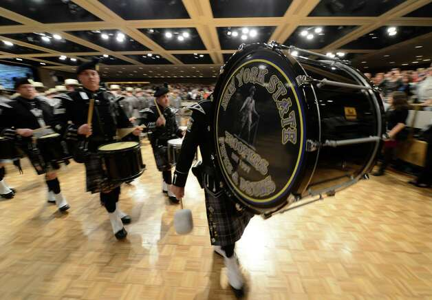 The NYSP Pipes and Drums lead the procession of  Class 198 of the New York State Police today at the New York State Police Graduation at the Empire State Plaza Convention Center in Albany, N.Y. Oct 16, 2012.       (Skip Dickstein/Times Union) Photo: Skip Dickstein / 00019675A