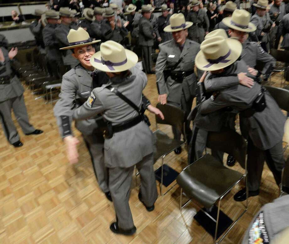 Members of the Class 198 of the New York State Police celebrate after the ceremony at the New York State Police Graduation at the Empire State Plaza Convention Center in Albany, N.Y. Oct 16, 2012.       (Skip Dickstein/Times Union) Photo: Skip Dickstein / 00019675A
