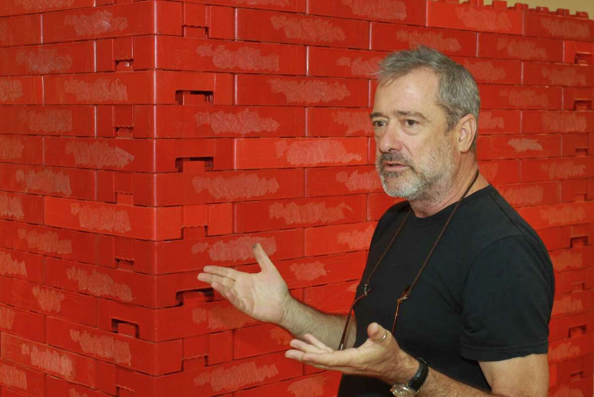 """(For the Chronicle/Gary Fountain, October 12, 2012) Artist Tony Feher, during a gallery talk near one of his works, """"Enjoy"""" 2001, which is made from 350 red plastic soda cases. The piece is on exhibit at the Blaffer Gallery at the University of Houston."""