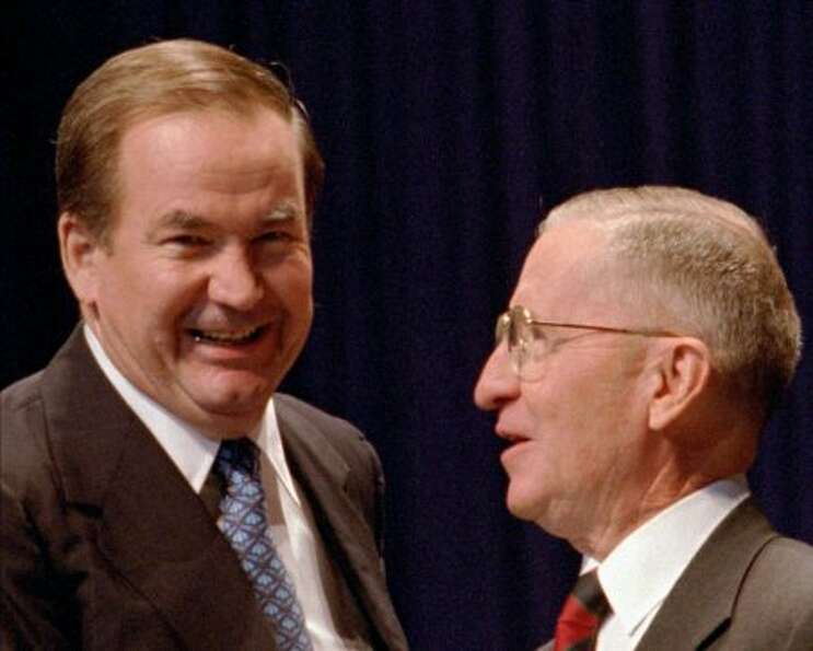 Pat Buchanan, left, is welcomed to the United We Stand America National Conference in Dallas, Saturd