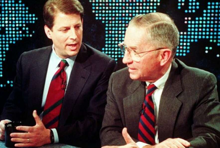 Vice President Al Gore and Ross Perot talk during a break on a television debate about the North Ame