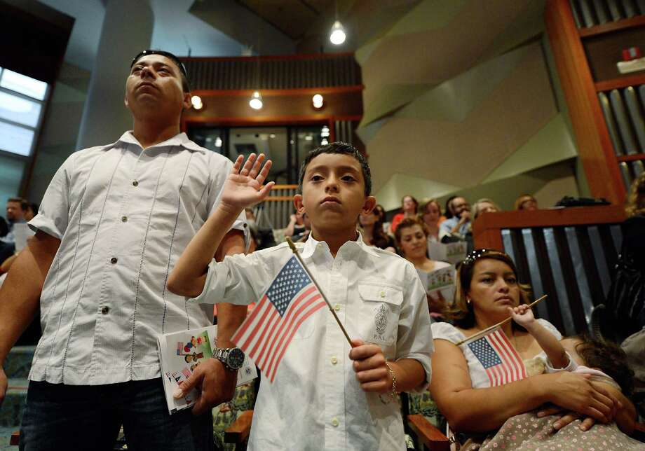 Immigrants: About 13 percent of the people living in America were born in another country. That's 40.3 million people, or about four times the combined population of Washington and Oregon. Which city is attracting the most immigrants? Photo: Kevork Djansezian, Getty Images / 2012 Getty Images