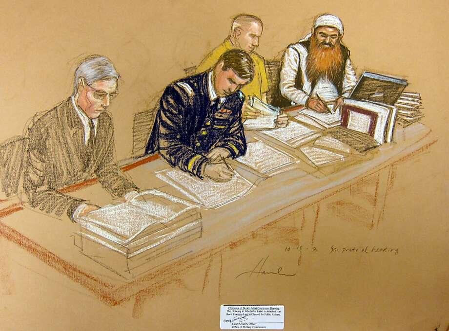 In this photo of a sketch by courtroom artist Janet Hamlin and reviewed by the U.S. Department of Defense, Khalid Sheikh Mohammed, far right, writes on a paper as he sits at the defense table with his legal team, Army Capt. Jason Wright, second from left, lawyer David Nevin, left, and a court translator during the Military Commissions pretrial hearing in the Guantanamo Bay U.S. Naval Base in Cuba, Monday, Oct. 15, 2012. Khalid Sheikh Mohammed, who has portrayed himself as the mastermind behind the Sept. 11 attacks, and four other co-defendants were back before a military tribunal, forgoing the protest that turned their last appearance into an unruly 13-hour spectacle. (AP Photo/Janet Hamlin, Pool) Photo: Janet Hamlin, Associated Press