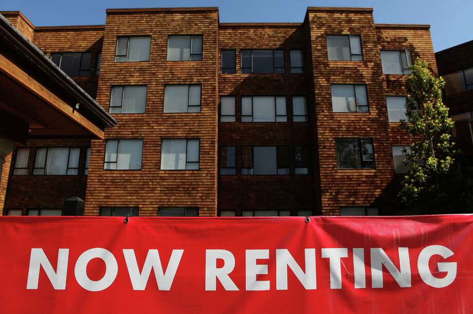 Rent: The median rent paid across the country is $871 a month. Portland and Seattle are both a bit steeper – $876 in Portland and $1,024 in Seattle – but which city sees more of its residents renting beyond their means? Photo: Justin Sullivan, Getty Images / 2009 Getty Images