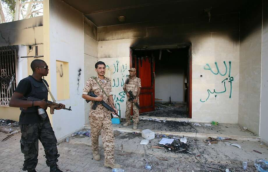 FILE - In this Sept. 14, 2012 file photo, Libyan military guards check one of the burnt out buildings at the U.S. Consulate in Benghazi, Libya, during a visit by Libyan President Mohammed el-Megarif to express sympathy for the death of American ambassador to Libya Chris Stevens and his colleagues in the Sept. 11, 2012 attack on the consulate. The White House has put special operations strike forces on standby and moved drones into the skies above Africa, ready to strike militant targets from Libya to Mali ? if investigators can find the al-Qaida-linked group responsible for the attack. (AP Photo/Mohammad Hannon, File) Photo: Mohammad Hannon, Associated Press