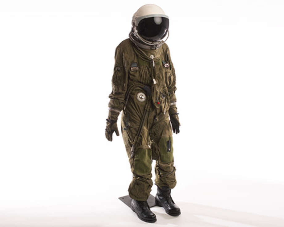 An S-1010 pressure suit for a U-2R spy plane. At altitudes above 63,000 feet without artificial air pressure, human blood and other fluids boil. Pressure suits prevented this in the event of cockpit depressurization and protected pilots from low temperatures that reached about minus 70 degrees at U-2 mission altitudes. If the pilot had to eject, he would free fall for two to three minutes before parachute deployment. The suit also provided flotation for a water landing. The helmet includes a one-way exhalation valve near the right cheek, allowing breath to pass from a section over the eyes, nose, mouth and chin to a second compartment housing the rest of the head. The pilot could ingest liquid and paste food through a feeding port in the front of the helmet. Photo: Central Intelligence Agency