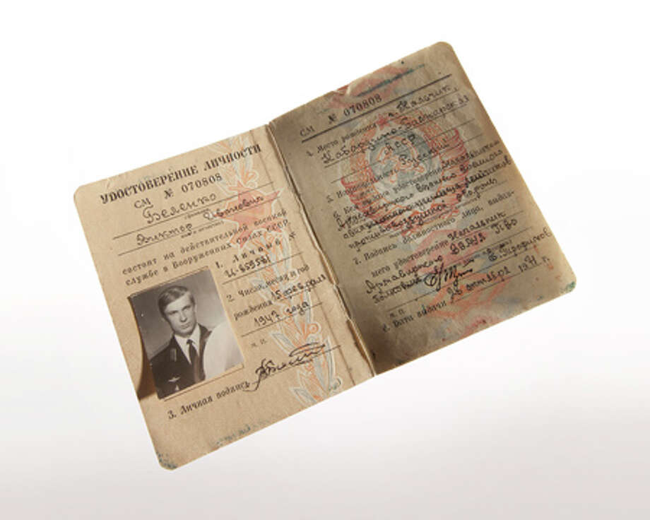 "When Soviet Lt. Viktor I. Belenko defected in a MiG‑25 Foxbat fighter to Japan on Sept. 6, 1976, he carried two personal items: this military identity document and a knee-pad notebook with flight data. The Japanese Government returned the MiG to the Soviet Union disassembled, in 30 crates. Belenko accepted asylum in the United States, went through months of debriefings and became an American citizen by an act of Congress when President Jimmy Carter signed a private bill into law. He settled on a ranch in Wyoming, went hiking and fishing with fighter ace and test pilot Chuck Yeager, and cooperated with author John Barron to produce a biography, ""MiG Pilot, The Final Escape of Lieutenant Belenko,"" published in 1980. Photo: Central Intelligence Agency"