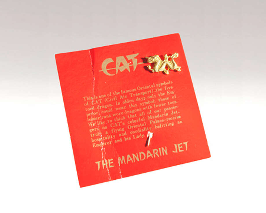 "This is a souvenir given to guests on the Mandarin Jet of Civil Air Transport, an airline started in China after World War II and secretly purchased by the CIA in August 1950. After the purchase, the airline continued commercial operations, while also providing airplanes and crews for secret intelligence operations. The card says: ""This is one of the famous Oriental symbols of CAT (Civil Air Transport) – the five-toed dragon. In olden days only the emperor could wear this symbol; those of lesser rank wore dragons with fewer toes.  We like to think that all of our passengers on CAT's colorful Mandarin Jet – truly a flying Oriental Palace – receive hospitality and cordiality befitting an emperor and his Lady."" Photo: Central Intelligence Agency"