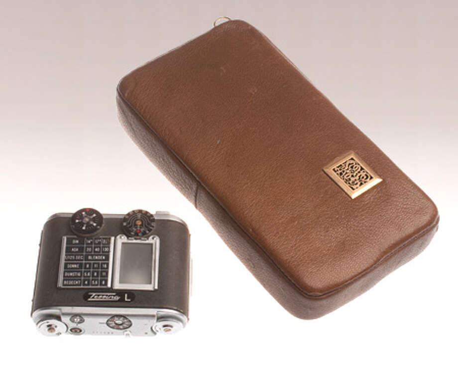 A miniature 35-mm film camera manufactured in Switzerland is concealed in this modified tobacco pouch. A spring-wound mechanism advanced the film between exposures. Photo: Central Intelligence Agency