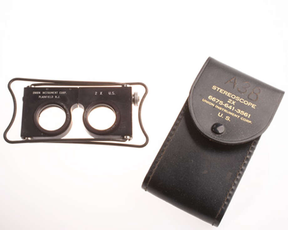 During World War II, Allied photographic interpreters used the stereoscope to get three-dimensional views of stereo pairs of images taken by airplane-mounted cameras. Photo: Central Intelligence Agency