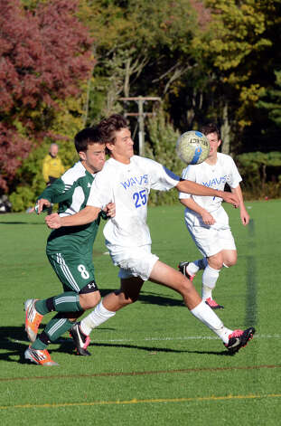 Darien's Alexei Gunya (25) controls the ball as Norwalk's Matt Capomolla (8) defends during the boys soccer game at Darien High School on Tuesday, Oct. 16, 2012. Photo: Amy Mortensen / Connecticut Post Freelance