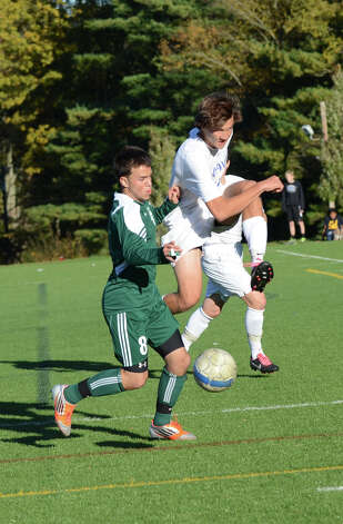 Darien's Alexei Gunya (25) and Norwalk's Matt Capomolla (8) battle for control of the ball during the boys soccer game at Darien High School on Tuesday, Oct. 16, 2012. Photo: Amy Mortensen / Connecticut Post Freelance