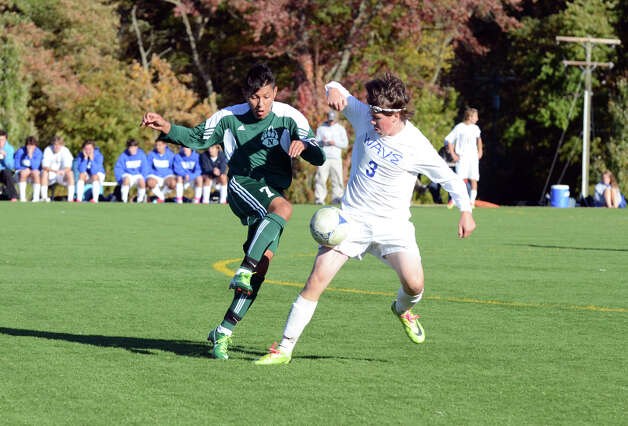 Norwalk's Alejandro Rivera (7) and Darien's Andrew Dirvin (3) fight for control of the ball during the boys soccer game at Darien High School on Tuesday, Oct. 16, 2012. Photo: Amy Mortensen / Connecticut Post Freelance
