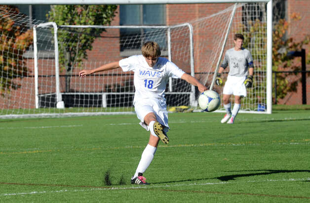 Darien's Marcus Iqbal (18) puts the ball in play during the boys soccer game against Norwalk at Darien High School on Tuesday, Oct. 16, 2012. Photo: Amy Mortensen / Connecticut Post Freelance