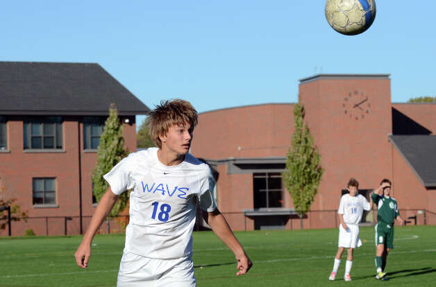 Darien's 	Marcus Iqbal (18) heads the ball during the boys soccer game against Norwalk at Darien High School on Tuesday, Oct. 16, 2012. Photo: Amy Mortensen / Connecticut Post Freelance