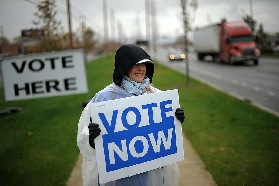An Ohio Democratic Party volunteer encourages early voting at a polling place in Columbus. Photo: Jewel Samad, AFP/Getty Images