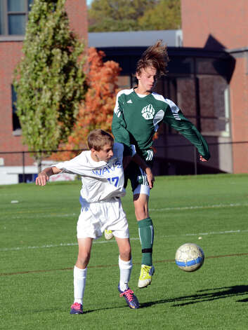 Darien's Bartosz Dziedzic (17) and Norwalk's Nicolas Samperez (21) during the boys soccer game at Darien High School on Tuesday, Oct. 16, 2012. Photo: Amy Mortensen / Connecticut Post Freelance