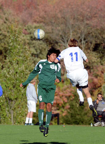 Norwalk's Jose Canahui (6) and Darien's Spencer McMullin (11) fight for control of the ball during the boys soccer game at Darien High School on Tuesday, Oct. 16, 2012. Photo: Amy Mortensen / Connecticut Post Freelance