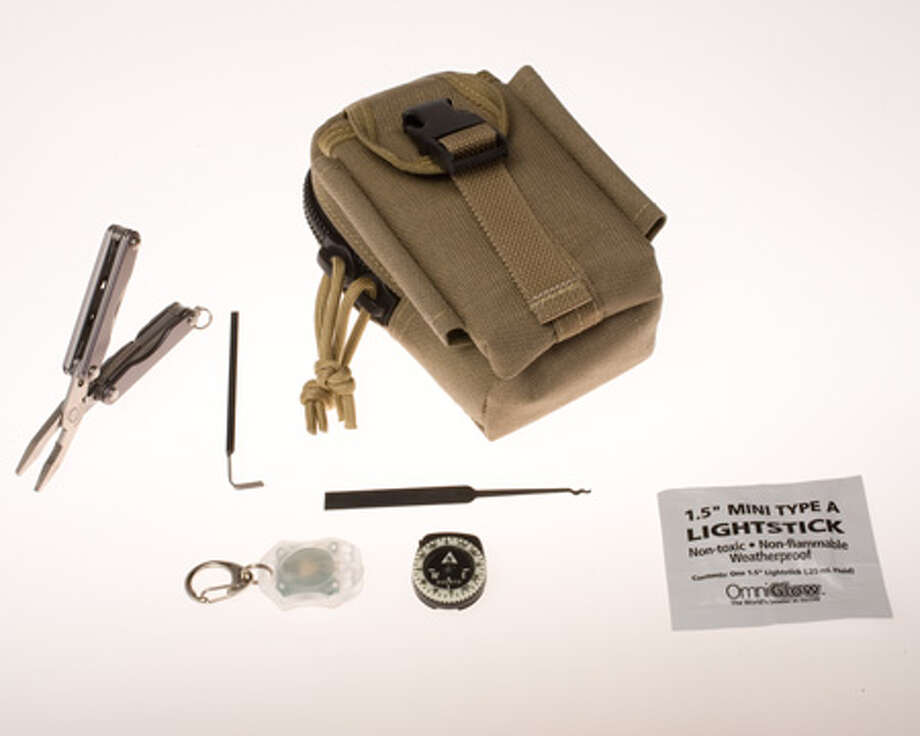 An escape and evasion survival kit designed for use by special operations personnel. It contains such tools as a diamond wire to cut metal, fishing equipment, a ceramic blade, a can opener, lock picks and a mini-Leatherman tool. Photo: Central Intelligence Agency