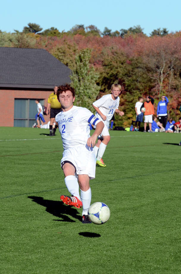 Darien's Brennan Branca (2) passes the ball during the boys soccer game against Norwalk at Darien High School on Tuesday, Oct. 16, 2012. Photo: Amy Mortensen / Connecticut Post Freelance