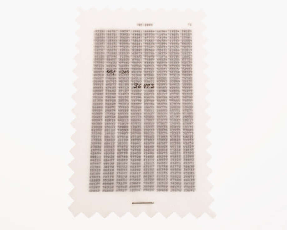 One-time pads are used to for coded communications. They are issued in matching sets of two:  one pad of sheets for the encoder and a matching pad for the decoder. No two sets and no two sheets within a set are alike. Each sheet contains a random key using five-digit groups. Once a sheet has been used to encode a message, it is torn off the pad and destroyed. Photo: Central Intelligence Agency
