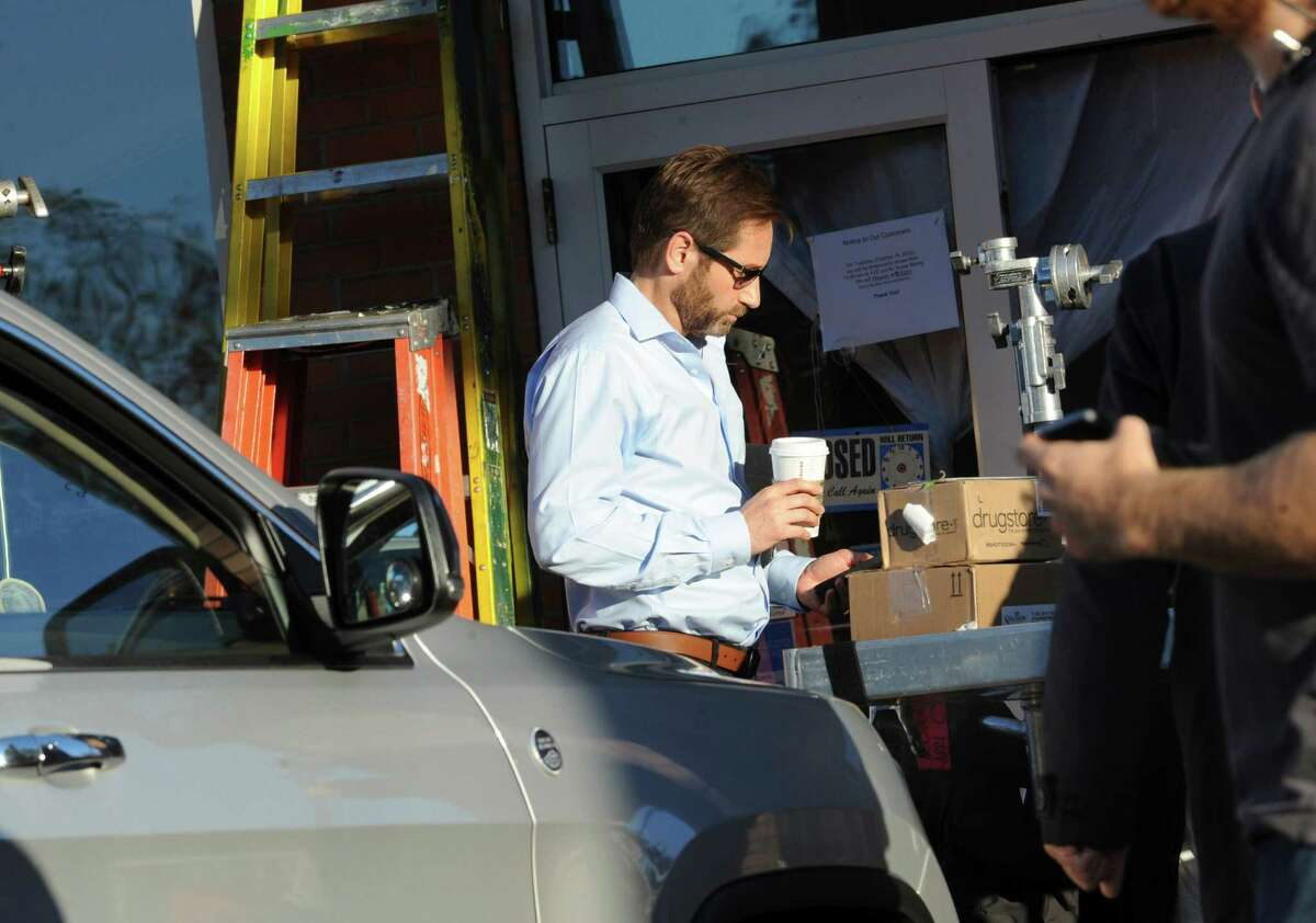Actor David Duchovny on the set of the film ìAfter the Fall,î a movie based on the true story of a Greenwich family that makes it their mission to build a world-class children's hospital after the death of their daughter, Tuesday, Oct. 16, 2012, at the Whole Foods Market shopping center in Greenwich. The movie will also shoot scenes at the town-owned Nathaniel Witherell nursing home on Parsonage Road.