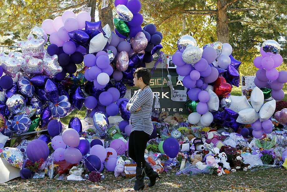 A memorial near Jessica Ridgeway's home blooms with the 10-year-old's favorite color, purple. As residents pay tribute, law enforcement is asking them to look hard at those around them. Photo: Ed Andrieski, Associated Press