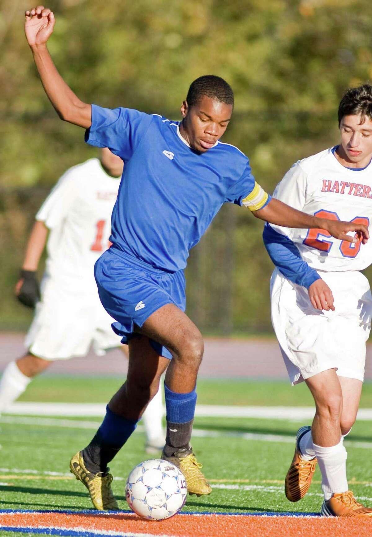 Harding High School's Ocasio Brown maneuvers the ball against Danbury High School in a game at Danbury. Tuesday, Oct. 16, 2012