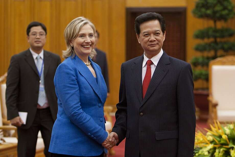 U.S. Secretary of State Hillary Rodham Clinton visits Vietnamese Prime Minister Nguyen Tan Dung. Photo: Nelson Ching, Bloomberg