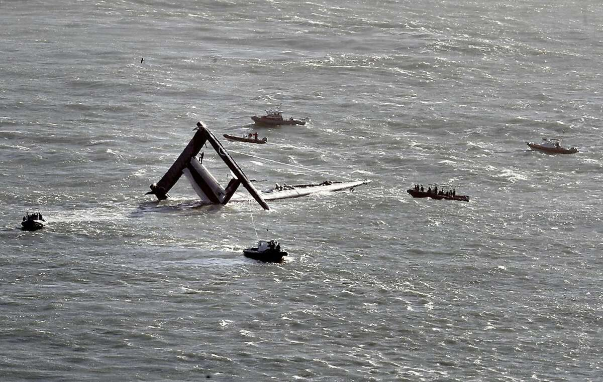 A 72 foot Oracle vessel training for the America's Cup, capsized in San Francisco Bay Tuesday October 16, 2012 and currents carried it out into the ocean.