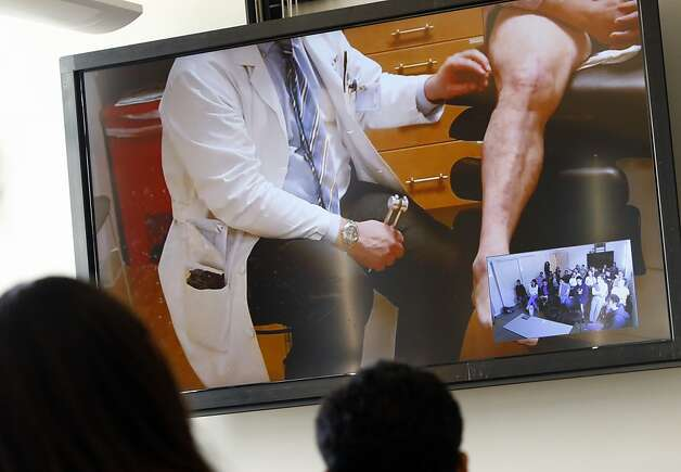 Students hold a video conference with a doctor and patient in the new lab. Photo: Sarah Rice, Special To The Chronicle