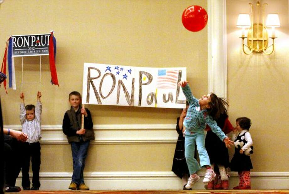 Young supporters of Texas Republican Ron Paul wait for Paul to arrive for a town hall meeting in Denver, Tuesday, Jan. 31, 2012. (Jack Dempsey / The Associated Press)
