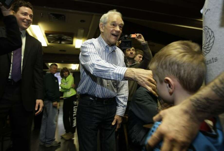 Texas Republican Ron Paul greets voters at Washington state caucus meetings, Saturday, March, 3, 2012, in Puyallup, Wash. (Ted S. Warren / The Associated Press)