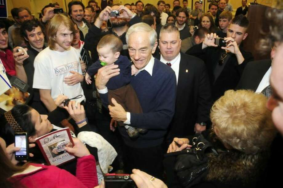 Ron Paul took time to hold 7-month-old Brody Grant of Gainesville, Ga. at the Spartanburg Marriott at Renaissance Park on Tuesday, Jan. 17, 2012, in Spartanburg, S.C. (Alex C. Hicks Jr. / The Associated Press)