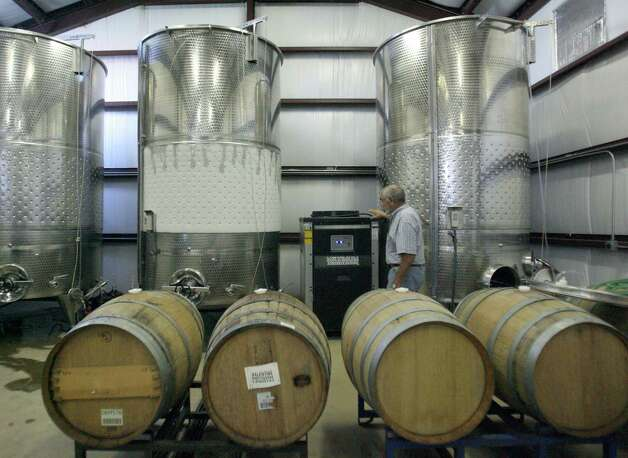 The winery includes three stainless steel vats and wooden barrels. Last year's grape harvest, the first ready for processing, was converted into about 9,500 bottles of wine this year. Photo: Delcia Lopez, For The Express-News / DELCIA LOPEZ PHOTOGRAPHY©