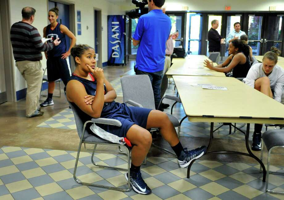 Connecticut's Kaleena Mosqueda-Lewis waits to be interviewed during their NCAA college basketball media day in Storrs, Conn., Tuesday, Oct. 16, 2012. (AP Photo/Jessica Hill) Photo: Jessica Hill, Associated Press / FR125654 AP