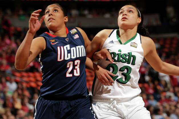 DENVER, CO - APRIL 01:  Kaleena Mosqueda-Lewis #23 of the Connecticut Huskies fights for rebound position in the first half against Kayla McBride #23 of the Notre Dame Fighting Irish during the National Semifinal game of the 2012 NCAA Division I Women's Basketball Championship at Pepsi Center on April 1, 2012 in Denver, Colorado.  (Photo by Doug Pensinger/Getty Images) Photo: Doug Pensinger, Getty Images / 2012 Getty Images