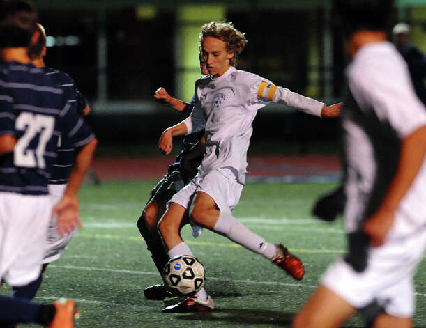 Fairfield Ludlowe's #10 Tobias Gimand kicks the winning goal shot, during boys soccer action against Staples in Fairfield, Conn. on Tuesday October 16, 2012. Photo: Christian Abraham / Connecticut Post