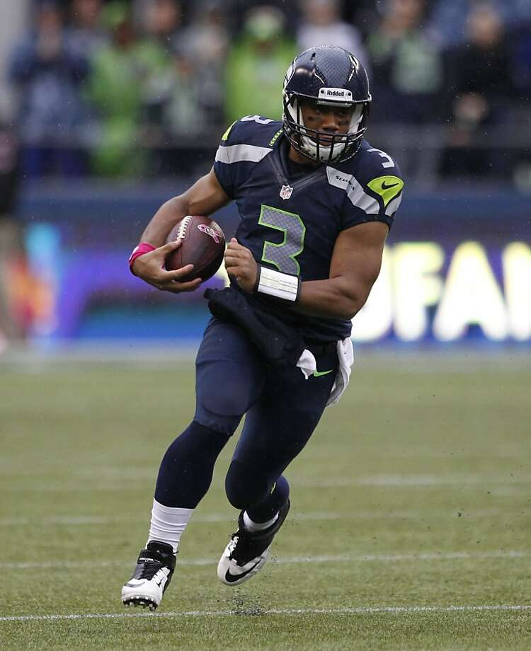 Like Alex Smith a year ago, Seattle's Russell Wilson is already exhibiting a flair for the dramatic. Photo: Elaine Thompson, Associated Press
